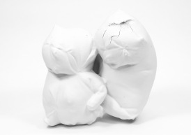 Fired slip-cast porcelain formed by pouring over a textile troll figure.