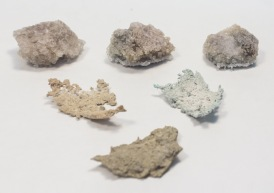 Textile rock formations coated in resin plaster which has been submerged in a crystallisation formula to develop a range of crystallised coatings.