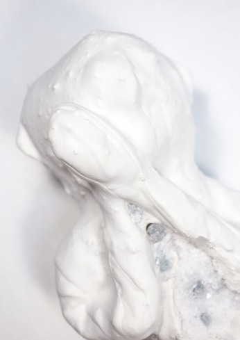 Textile troll formation coated in resin plaster and submerged in a crystallisation formula to allow crystals to grow on its surface.