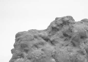 Expanding foam and textile troll figure coated in pigmented jesmonite.