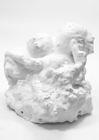 Expanding foam and textile based troll formation submerged in plaster.