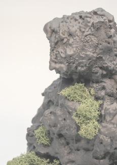 Textile troll figure coated in expanding foam, spray paint, jesmonite and living reindeer moss.