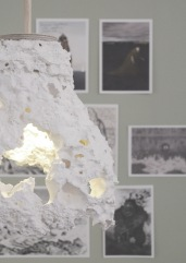 White manufactured lava-cast light from Cryptogeology display stand.