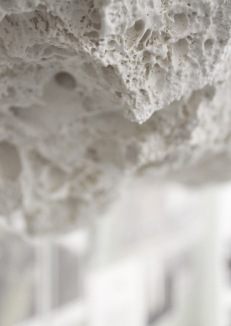 Close up of lava-cast texture featured on the shelves, stool, light and table at the Cryptogeology exhibit at Bath Spa Universities Degree Show.